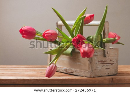 Tulip flowers in wooden box for Mother's Day celebration - stock photo