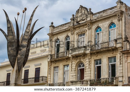 Tulip sculpture and old colonial building in Havana, Cuba - stock photo