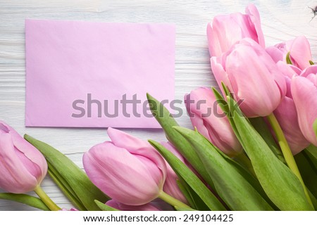 tulips and post card. March 8th, mother's day, valentine's day, International Women's Day, lilac, congratulate, celebrate - stock photo