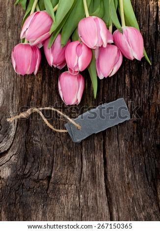 Tulips and slate - stock photo