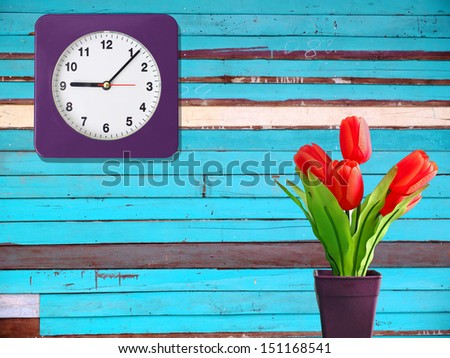 Tulips and wood wall,Decoration in room. - stock photo