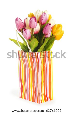 Tulips in shopping bag isolated on white - stock photo