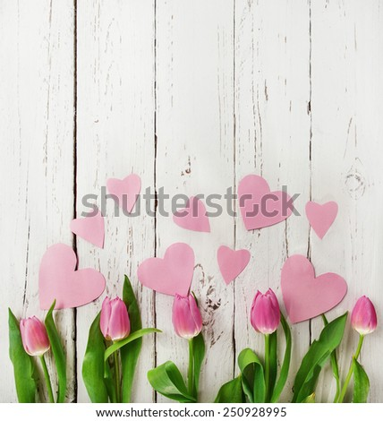 Tulips smelt by love concept picture with withe vintage boards background - stock photo
