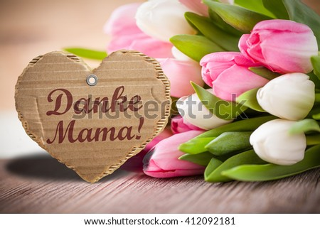 """tulips with message saying """"Thank you mama!"""" in German - stock photo"""