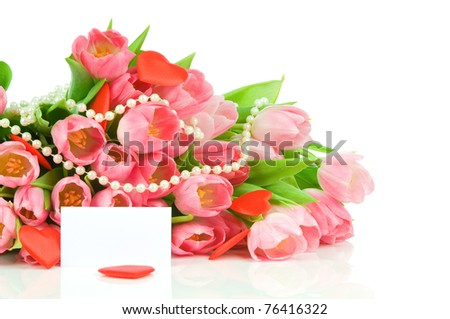 Tulips with red heart and greeting card isolated on white background