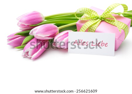 Tulips with tag and german text for mother's day - stock photo