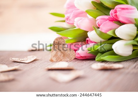 tulips with wooden hearts - stock photo