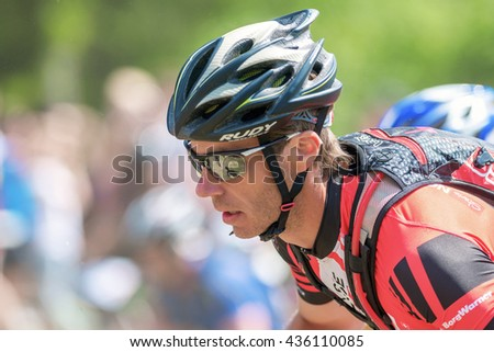 TULLINGE, SWEDEN - JUNE 12, 2016: Closeup of face of an cyclist at Lida loop mountainbike race. One of swedens biggest mountainbike races. - stock photo