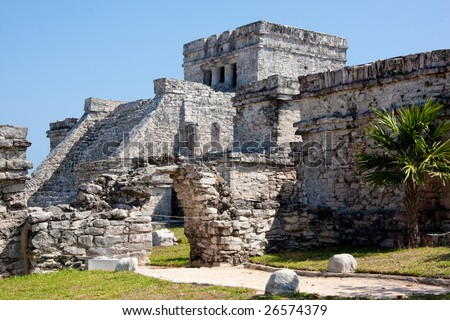 Tulum is one of the best-preserved coastal Maya sites and a popular site for tourists.  El Castillo (the castle), a temple with two columns portraying serpents. - stock photo