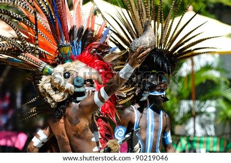 TULUM, MEXICO - FEBRUARY 17: Mayan Warriors in traditional dress, perform an ancient ritual dance on February 17, 2010 in Tulum, Mexico