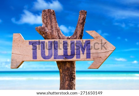 Tulum wooden sign with beach background - stock photo