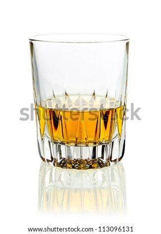 Tumbler of golden whisky or brandy served neat on a white studio background with reflection