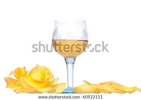 tumbler with white wine and yellow rose on the party