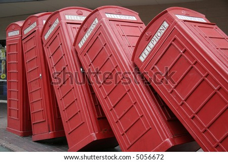 Tumbling Telephone Boxes. - stock photo