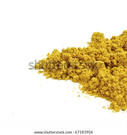 Tumeric powder, a yellow spice, on a white background.