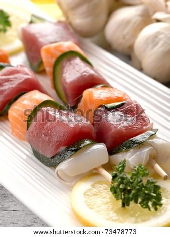 tuna and salmon skewers - stock photo