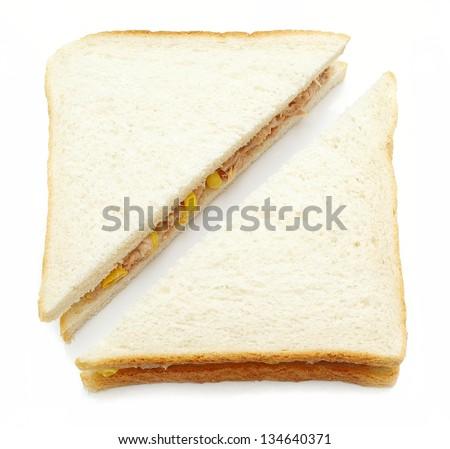 tuna and sweetcorn sandwich on white - stock photo