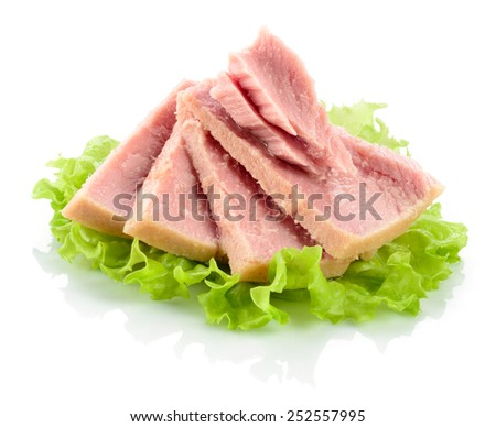 Tuna. Canned fish on green lettuce leaf - stock photo
