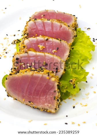 Tuna fillet with sesame isolated on white background - stock photo