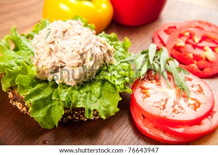Tuna fish sandwich on multigrain bread with lettuce and tomato