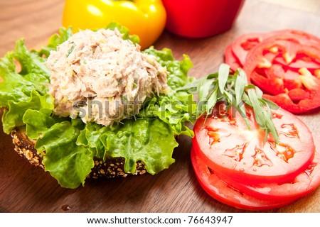 Tuna fish sandwich on multigrain bread with lettuce and tomato - stock photo