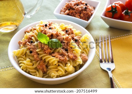 tuna pasta with black peppers  and basil leaf