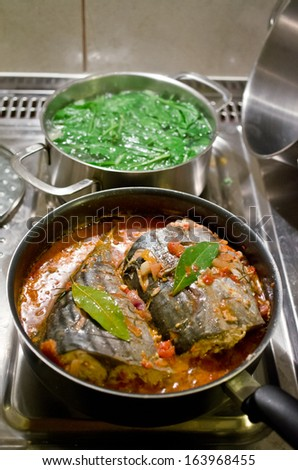 Tuna preparation in the pan - stock photo