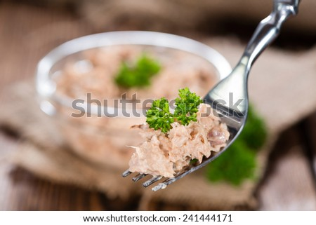 Tuna Salad on a fork topped with fresh parsley (close-up shot) - stock photo