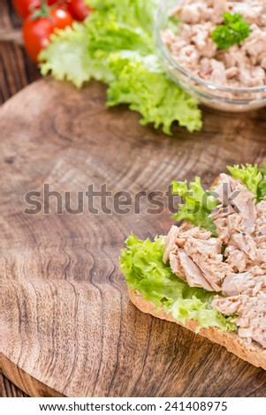 Tuna salad sandwich with a small bowl in the background - stock photo
