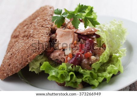 Tuna salad sandwich with lettuce, kidney beans and vegetables - stock photo