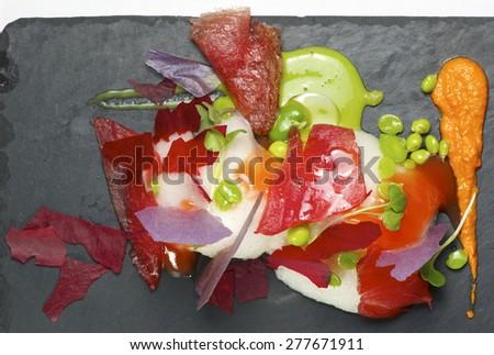 Tuna salad served on a tray slate. - stock photo