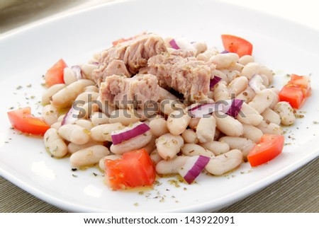 tuna salad with beans onion and tomato on plate - stock photo
