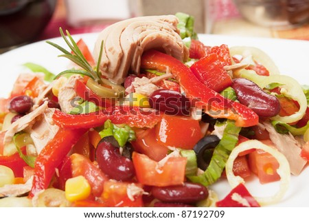 Tuna salad with beans, pepper, lettuce and corn - stock photo