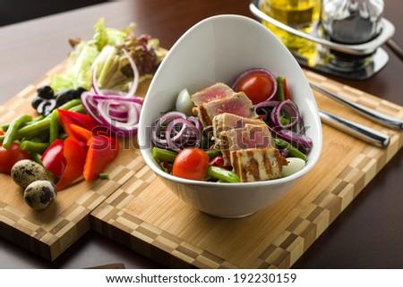Tuna salad with ingredients - stock photo
