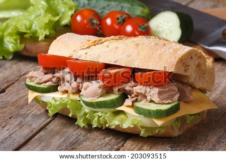 tuna sandwich with vegetables, cheese closeup on background of ingredients. horizontal   - stock photo