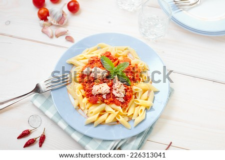 Tuna sauce half penne - stock photo