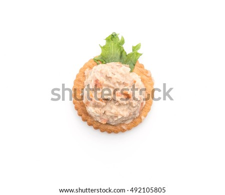 tuna spread with cracker on white background