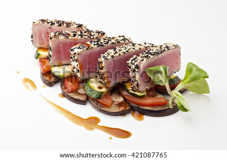 tuna steak with sesame and vegetables on a white background - stock photo