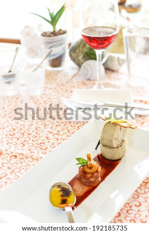 Tuna tartar marinated with sweet chili, lime and vegetables, octopus carpaccio and mango chutney - stock photo