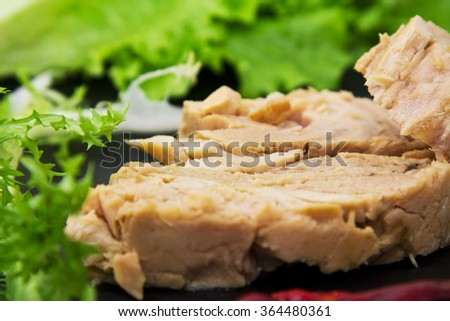 tuna with pepper on board - stock photo