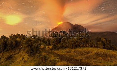 Tungurahua volcano erupting, Ecuador South America, very long exposure with star trails. - stock photo