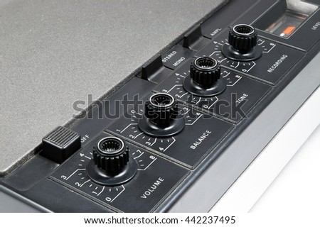 Tuning knobs of old retro stereo cassette recorder - stock photo