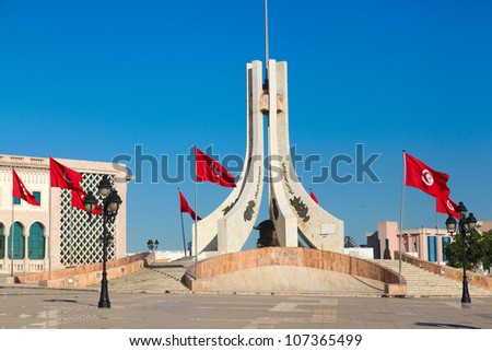 Tunis city square. Monuments and flags. - stock photo