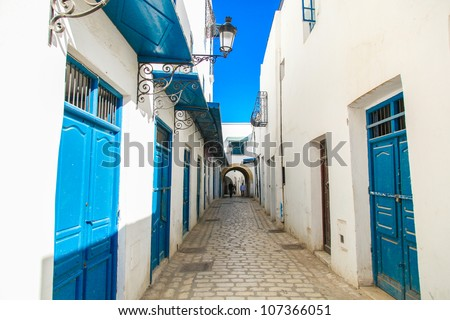 Tunis streets with traditional white and black painted buildings and architecture - stock photo
