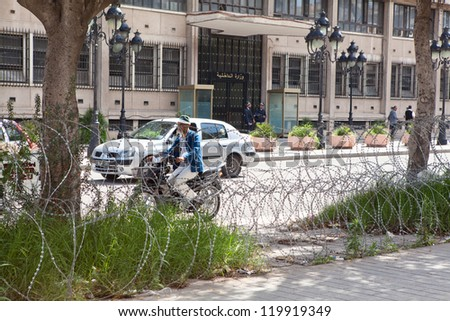 TUNIS, TUNISIA - CIRCA MAY, 2012: The barbed wire that separates the roadway and the pedestrian side of the road, on circa May, 2012 in Tunis, Tunisia.