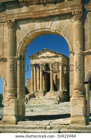 Tunisia. Ancient Sufetula (present day Sbeitla). Entrance to the forum via the triumphal arch. - stock photo