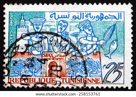 TUNISIA - CIRCA 1960: a stamp printed in Tunisia shows Oil, Flowers and Fish of Sfax, the Capital of the Sfax Governorate and Mediterranean Port, circa 1960