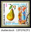 TUNISIA - CIRCA 1971: a stamp printed in Tunisia shows Pear and two Men under Pear Tree, Fruit and Folklore, circa 1971 - stock photo