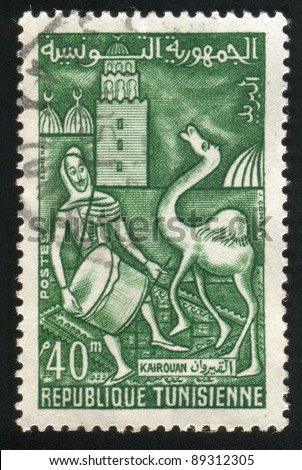 TUNISIA - CIRCA 1960: stamp printed by Tunisia, shows Festival at Kairouan, drummer and camel, circa 1960