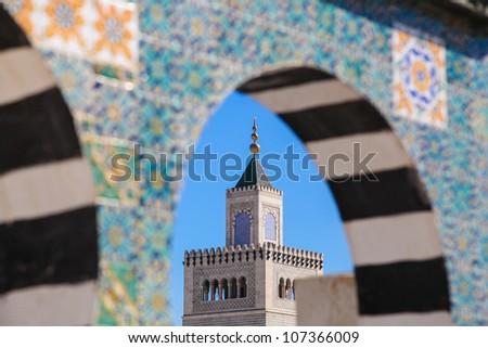 Tunisia old town of Medina. Terrace of Palais d'Orient with minaret of Zitouna Mosque - stock photo
